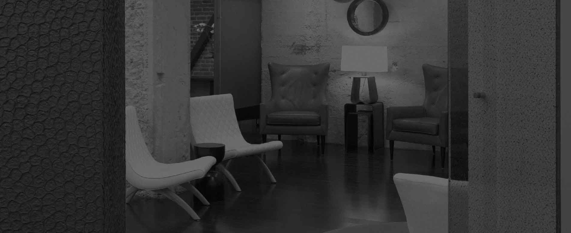 B&W image of a stylish waiting room.